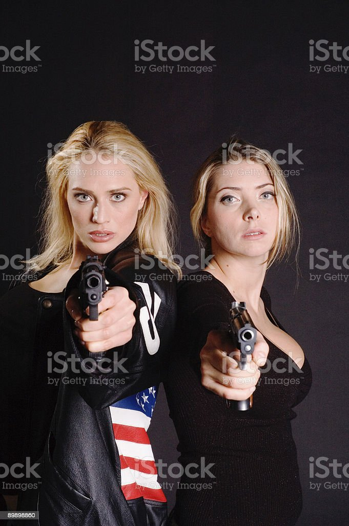 two hot sexy girls with guns royalty free stockfoto