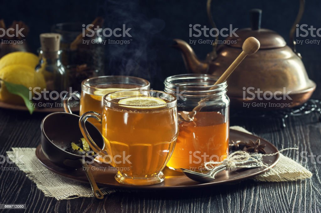 Two Hot Toddies or Lemon Spice Herbal Teas with Honey stock photo