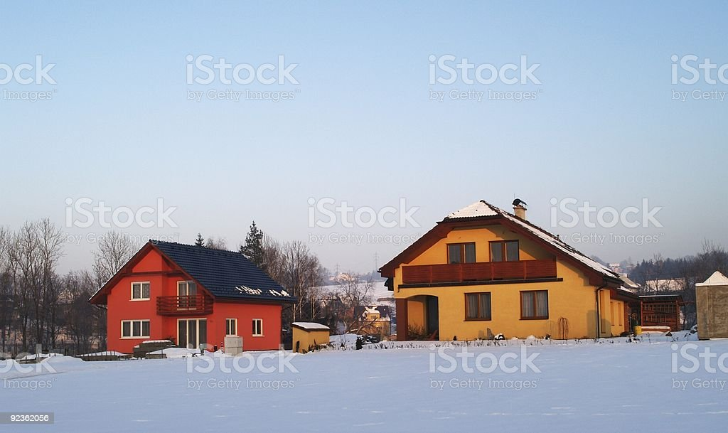 Two houses in winter royalty-free stock photo