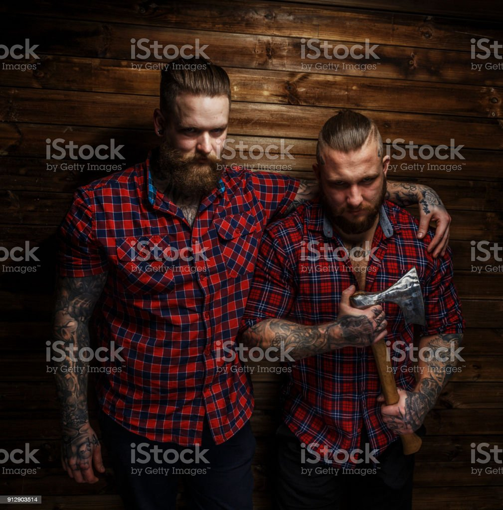 Two huge males with beards stock photo