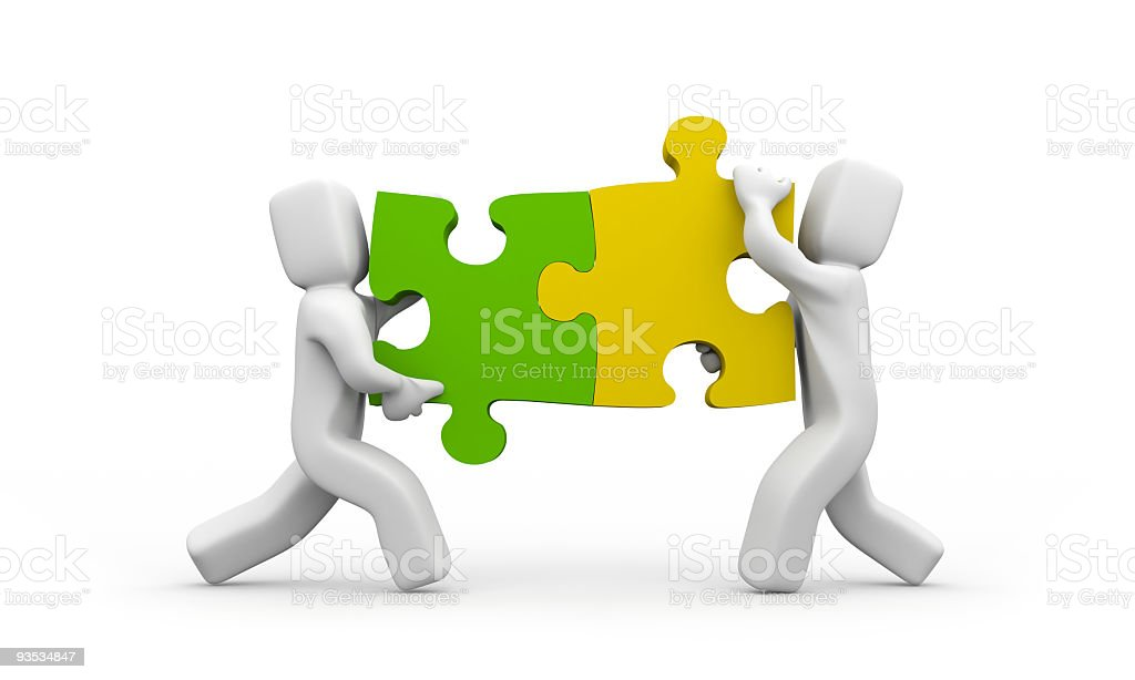 Two human figures holding puzzle pieces that fit together royalty-free stock photo