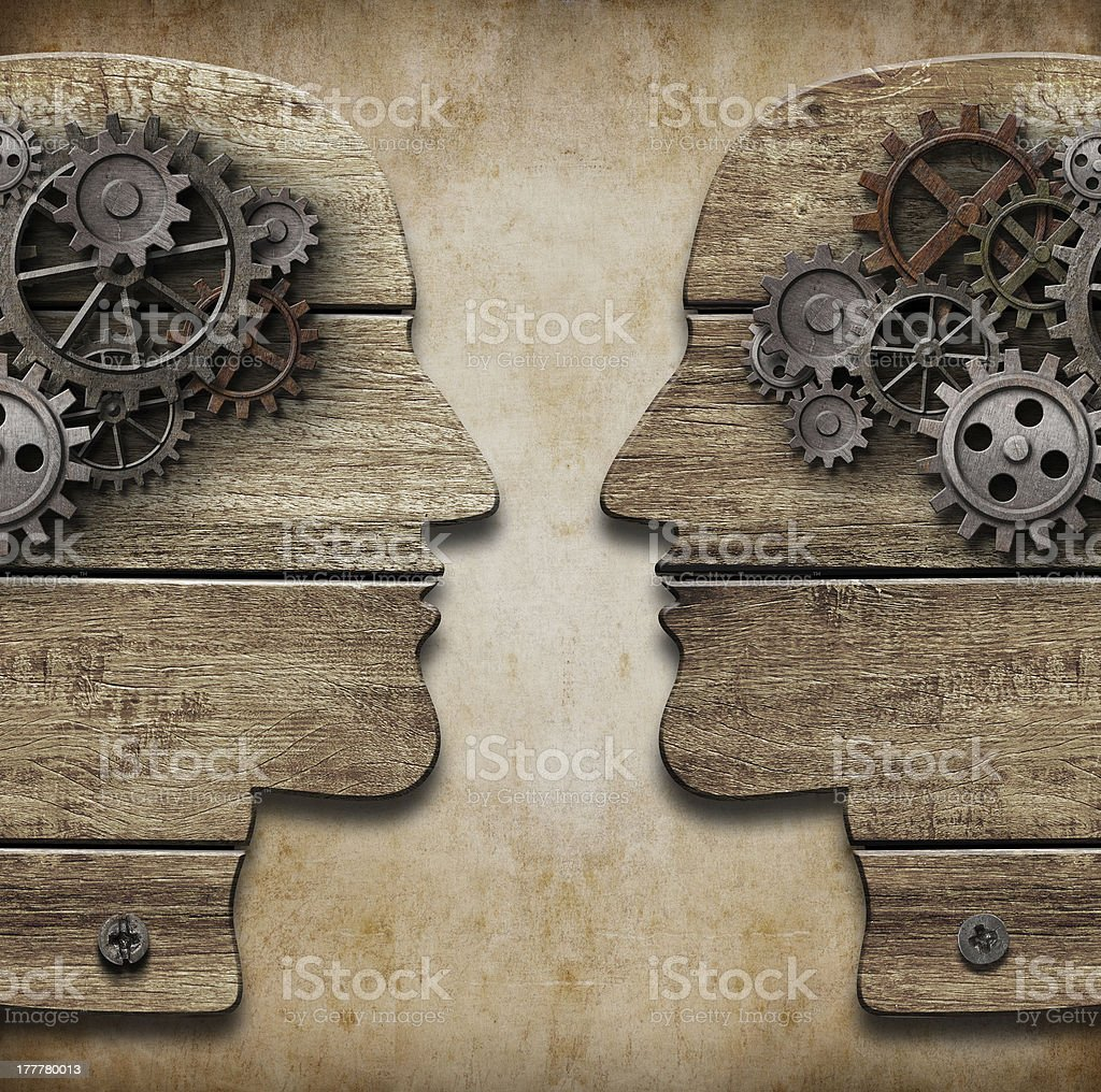 Two human head silhouettes with cogs and gears stock photo