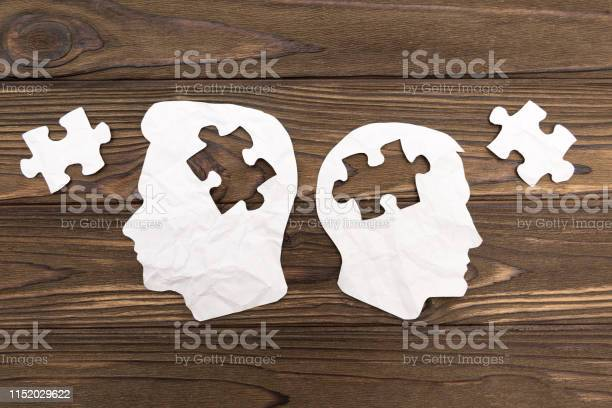 Two human head silhouettes with puzzles on wooden background picture id1152029622?b=1&k=6&m=1152029622&s=612x612&h=rkreo95krxucat0ehn288zt 1kreqhanmxc6z mtshw=