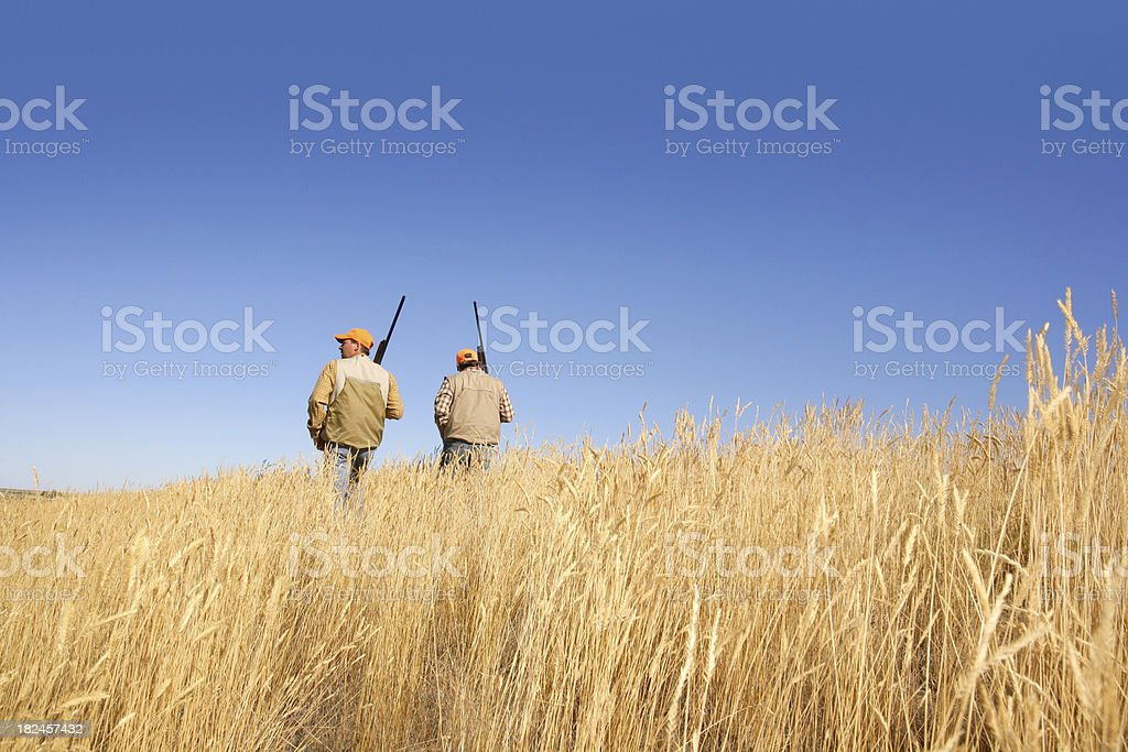 two hunters heading home stock photo