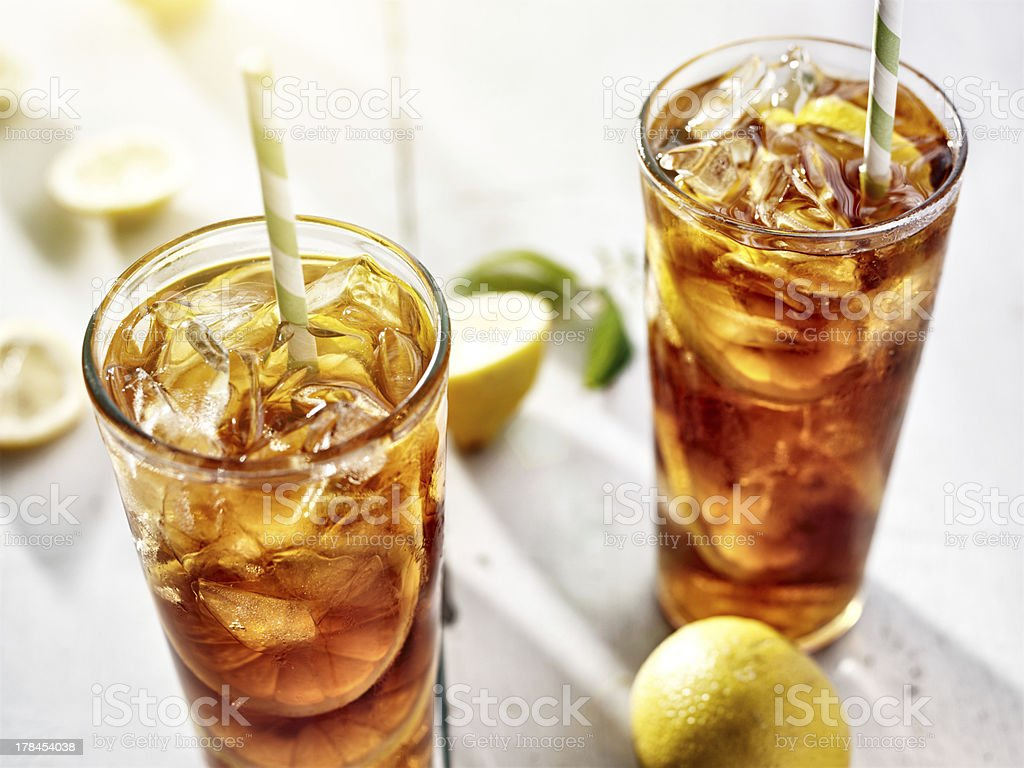 two ice cold glasses of iced tea with lemons stock photo