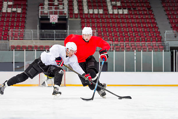 Two Ice Hockey Players Dueling stock photo