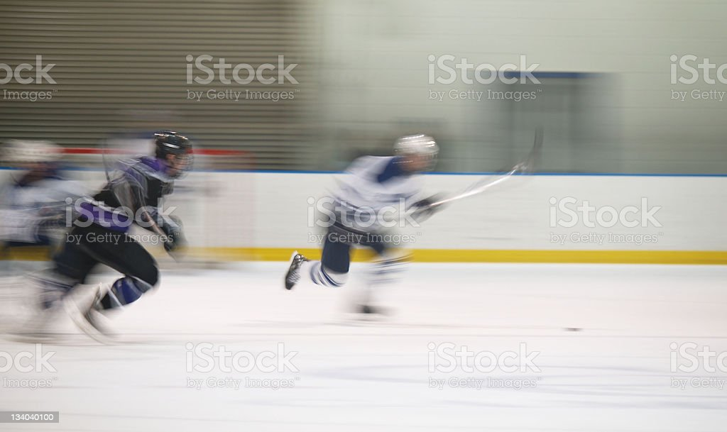 Two ice hockey players making a break for the puck stock photo
