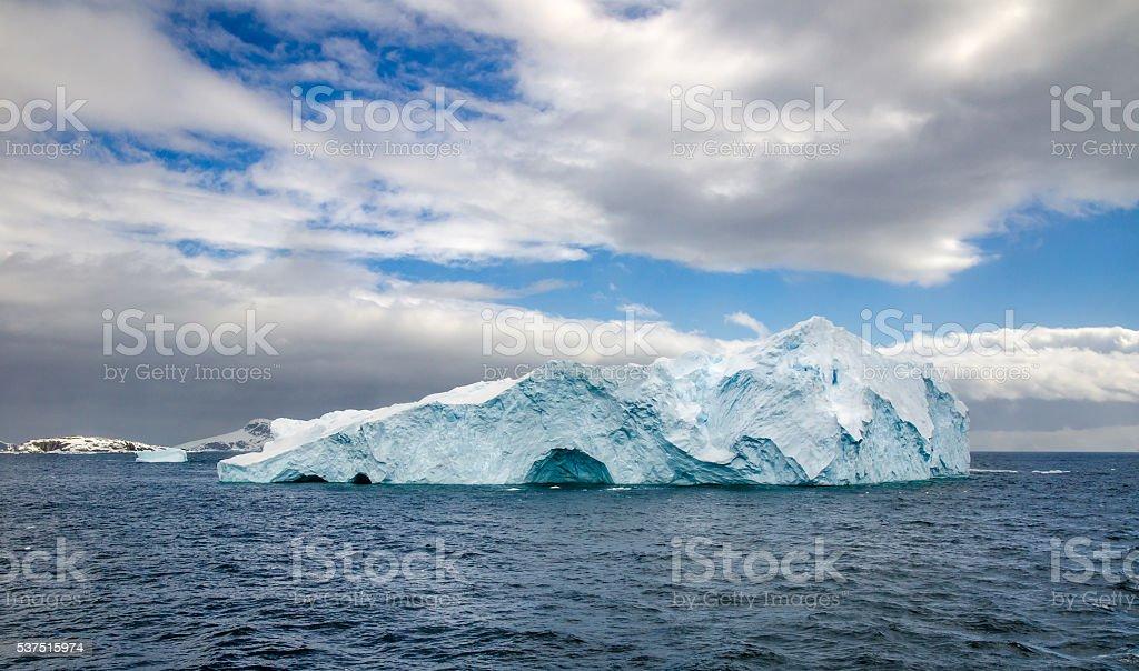 Two icebergs floating in Antarctica stock photo