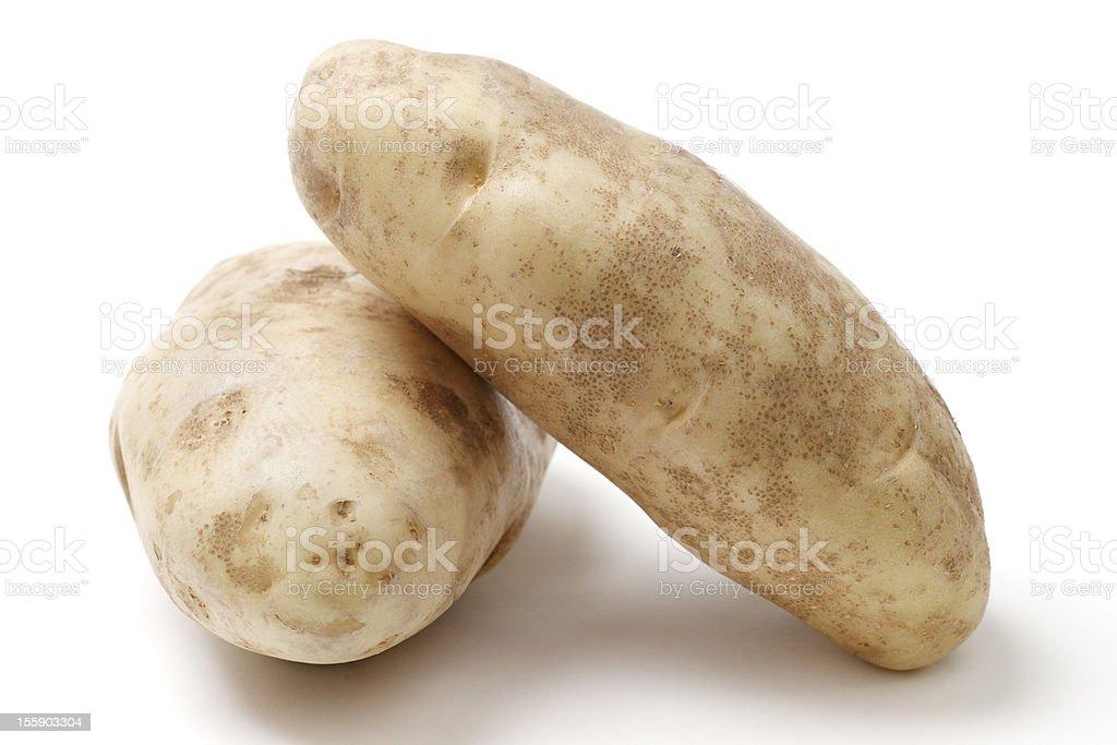 Two Idaho Russet Baking Potatoes against White Background royalty-free stock photo