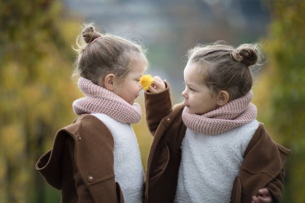 Two identical twin girls smelling a flower picture id870492180?b=1&k=6&m=870492180&s=612x612&w=0&h=xrnwy2lyi3s84ooxswqp16dkwhivkpamkk8gxaddkmy=