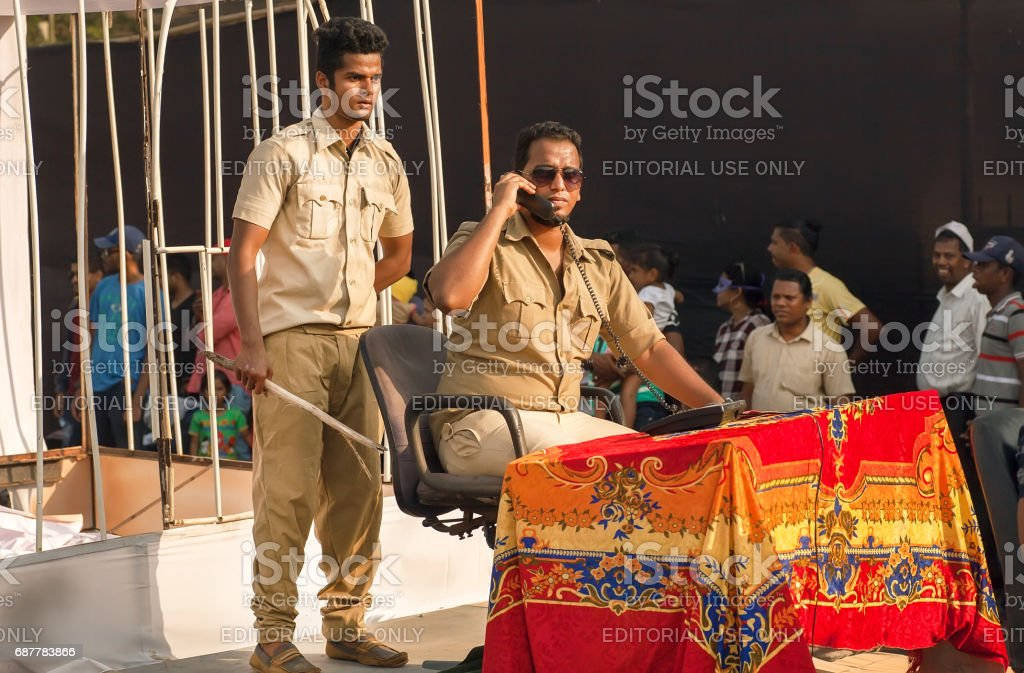 Two indian actors in uniform depict corruption of the police during show of the traditional Goa carnival stock photo
