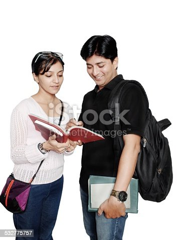 istock Two Indian college students discussing over white. 532775757