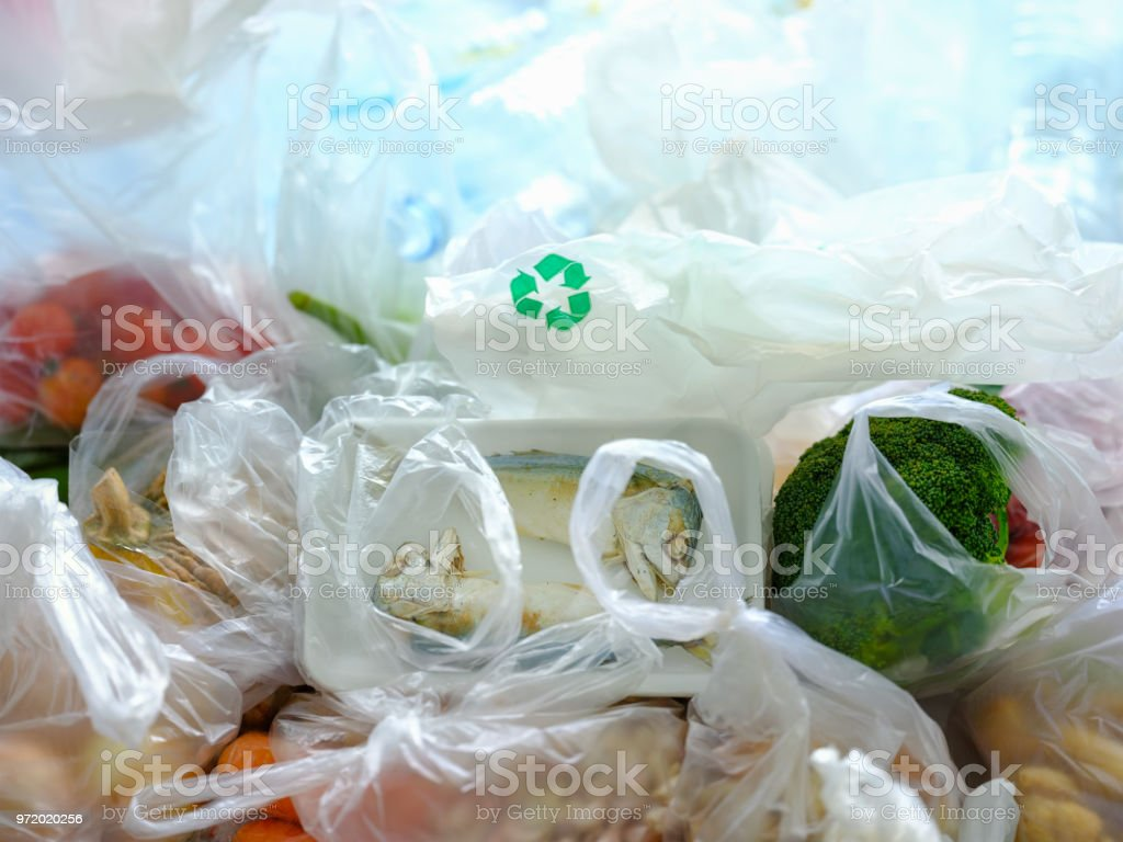 Two Indian Mackerel packaged in cling film on a polystyrene tray in a...