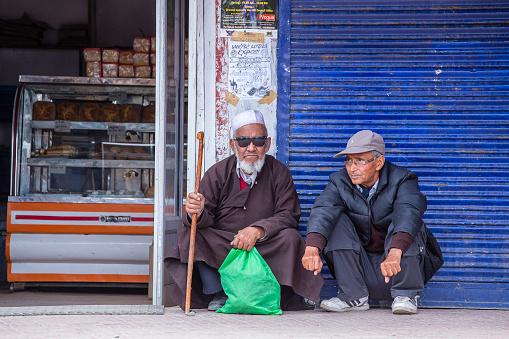 Leh, India - june 21, 2015 : Two Indian muslim men on the street market in mountain village Leh, Ladakh region, north India, close up