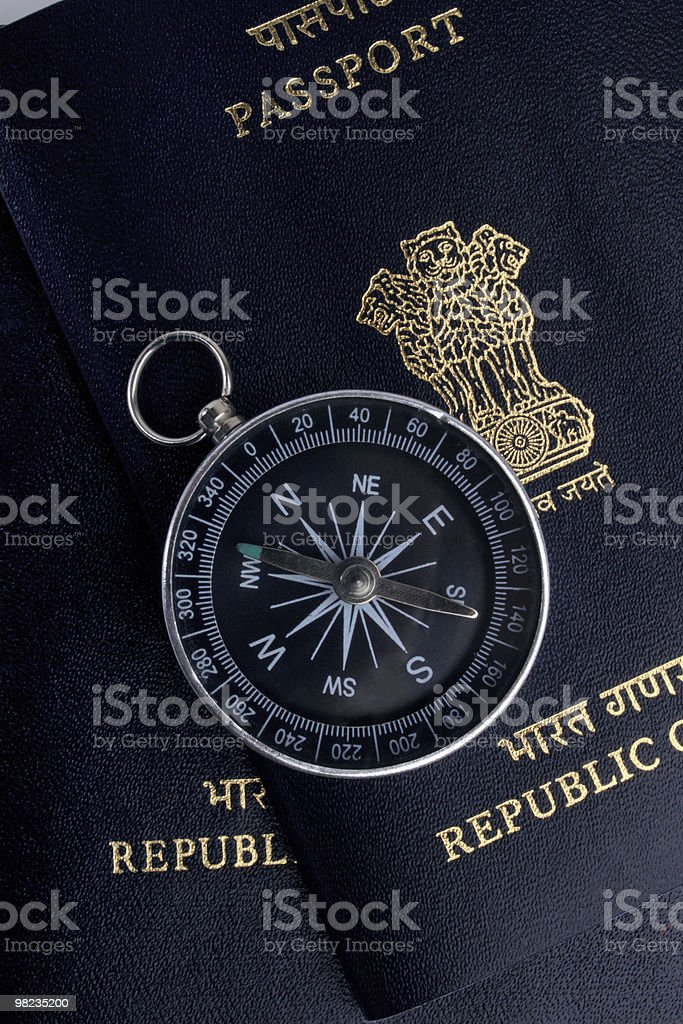 two indian passports and a magnetic compass royalty-free stock photo