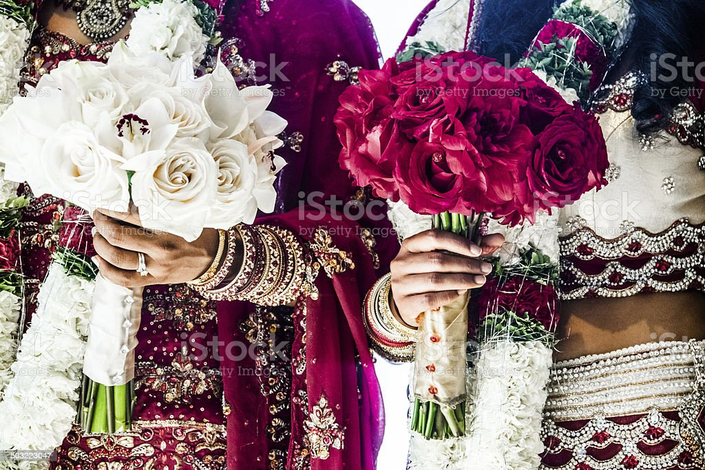 Two Indian Wedding Bouquets and brides stock photo