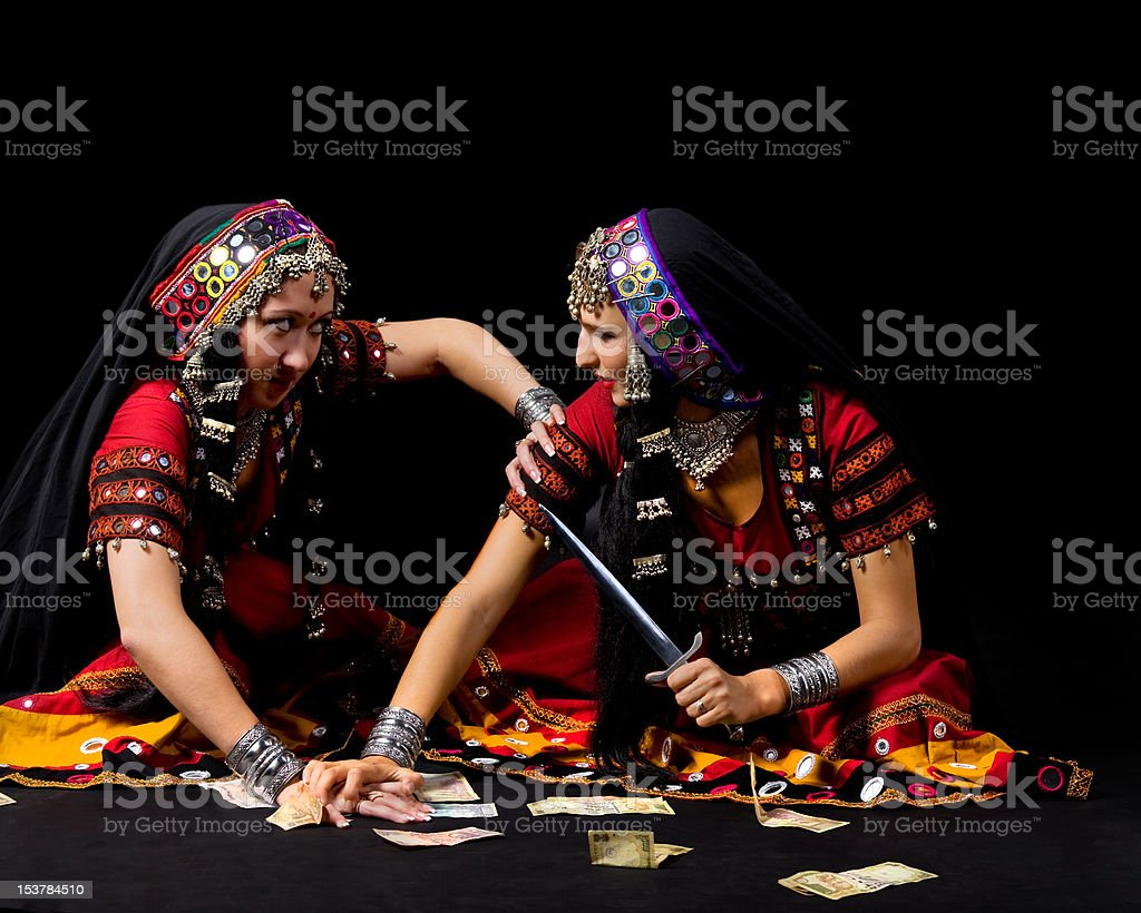 two indian woman fight for money with knife stock photo