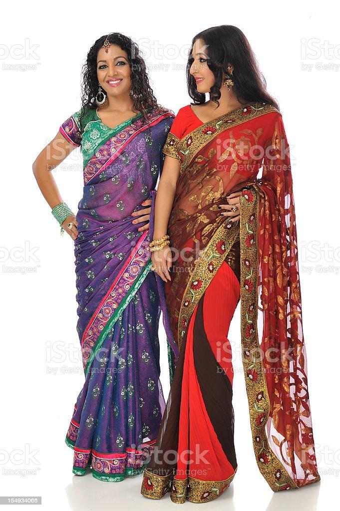 Two Indian women wearing saris royalty-free stock photo