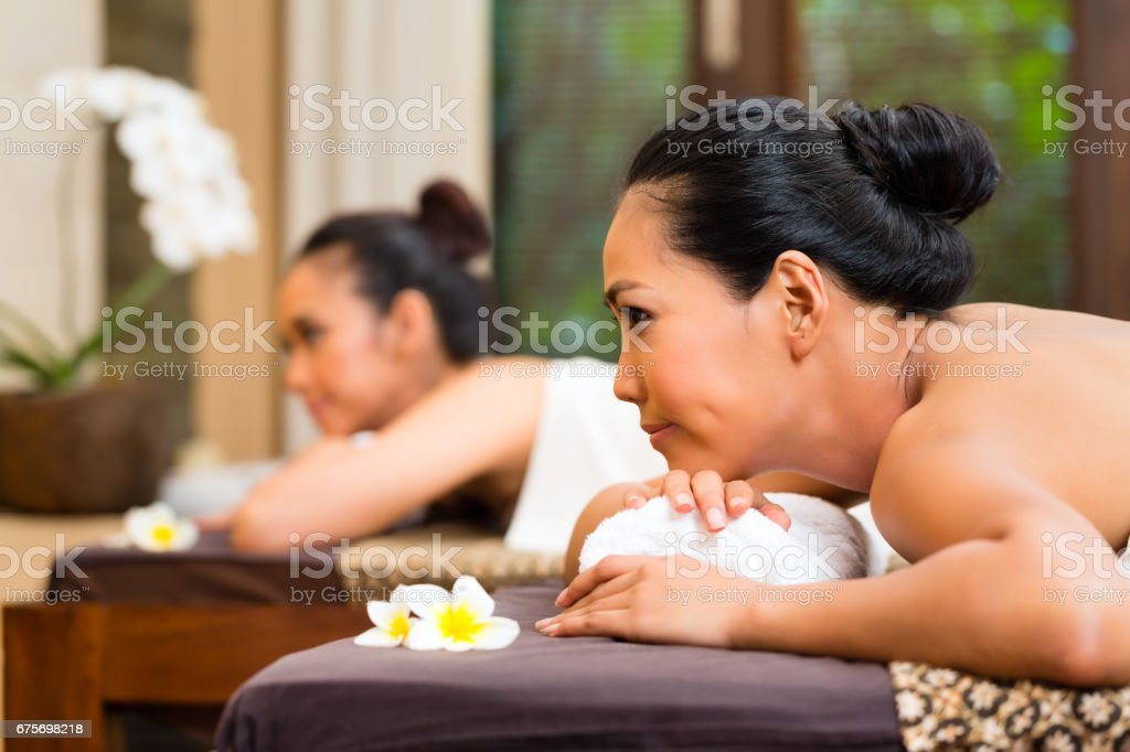 Two Indonesian women having wellness massage royalty-free stock photo