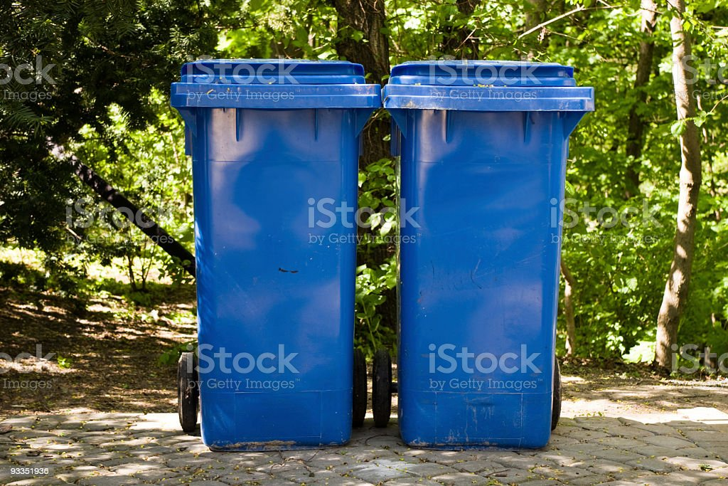 Two industrial trash bins royalty-free stock photo