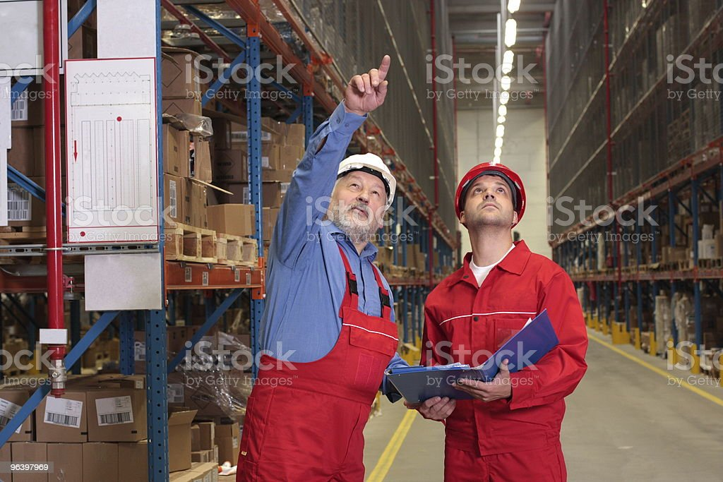 two inspectors in warehouse royalty-free stock photo