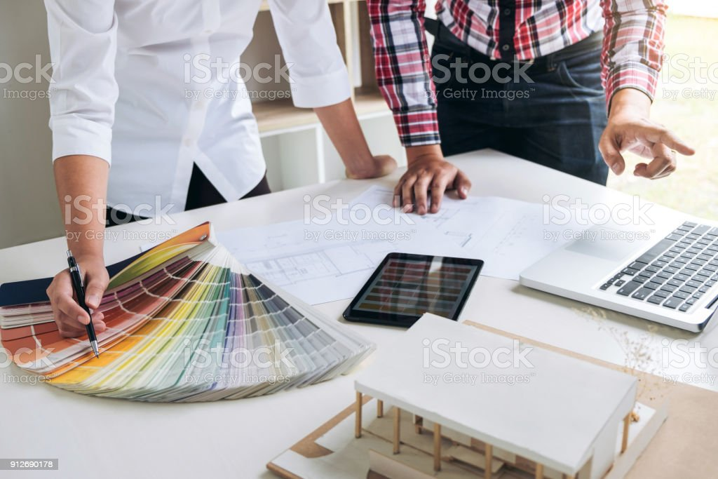 Two Interior Design Or Graphic Designer At Work On Project Of Architecture  Drawing With Work Tools