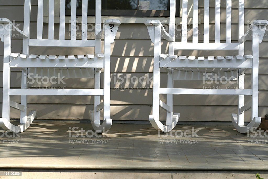 two inviting rocking chairs stock photo