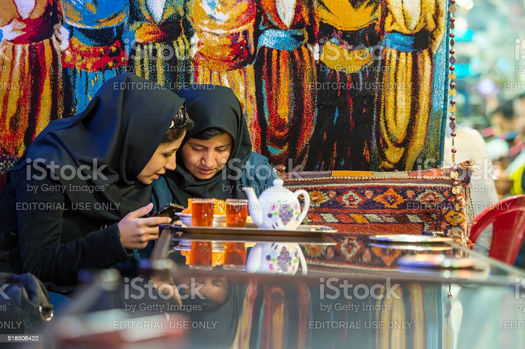 Two Iranian women in a traditional tea house, Isfahan, Iran stock photo