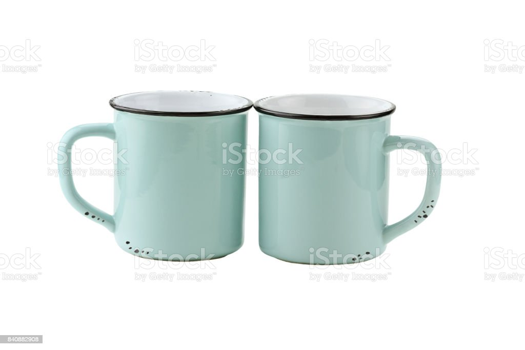Two Isolated Enamel Blue Coffee Cups stock photo