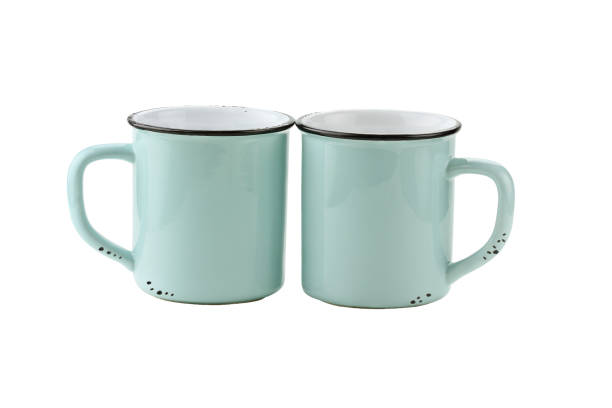 two isolated enamel blue coffee cups - enamel stock photos and pictures