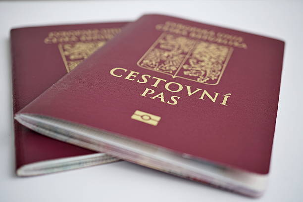 Two isolated red Czech passport with a state symbols Two isolated red Czech passport with a state symbols (lions and eagles) and captions Czech Republic and European Union in Czech language czech culture stock pictures, royalty-free photos & images