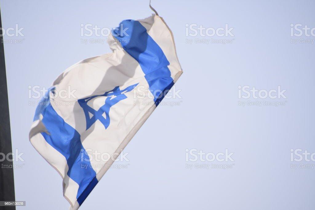 Two Israeli flags hang on a pole - Zbiór zdjęć royalty-free (Bez ludzi)
