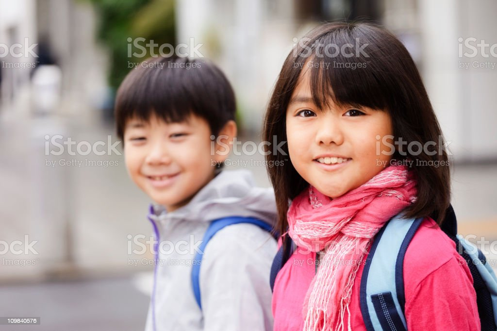 Two Japanese Children Standing on a City Street stock photo