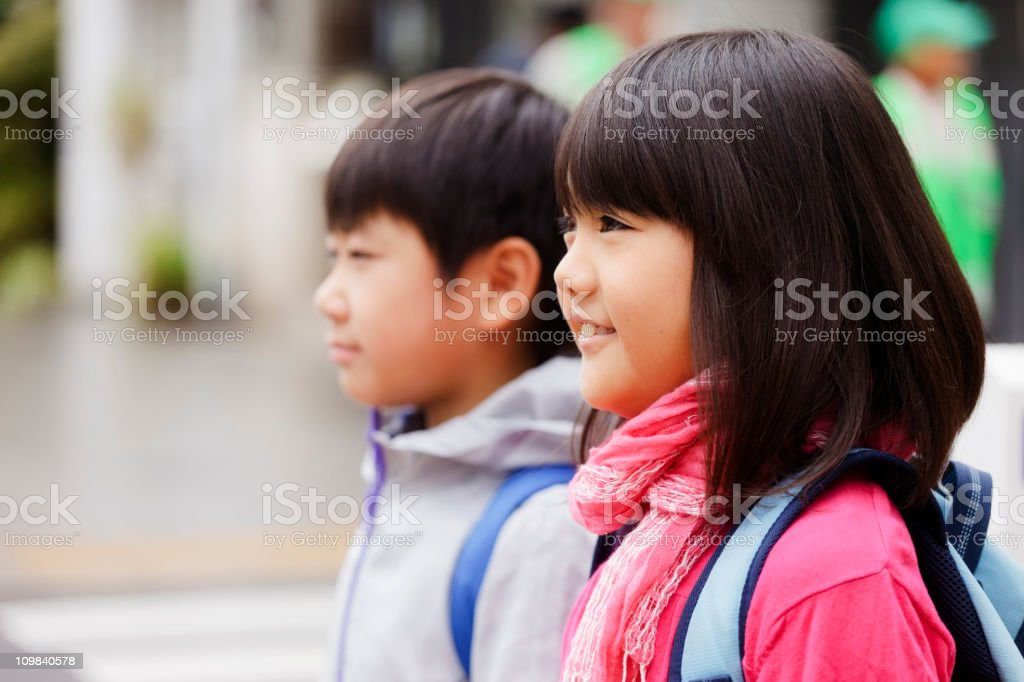 Two Japanese Children Standing on a City Street royalty-free stock photo