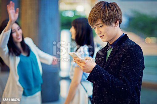 istock Two japanese girls are flirting with a shy boy 683119026