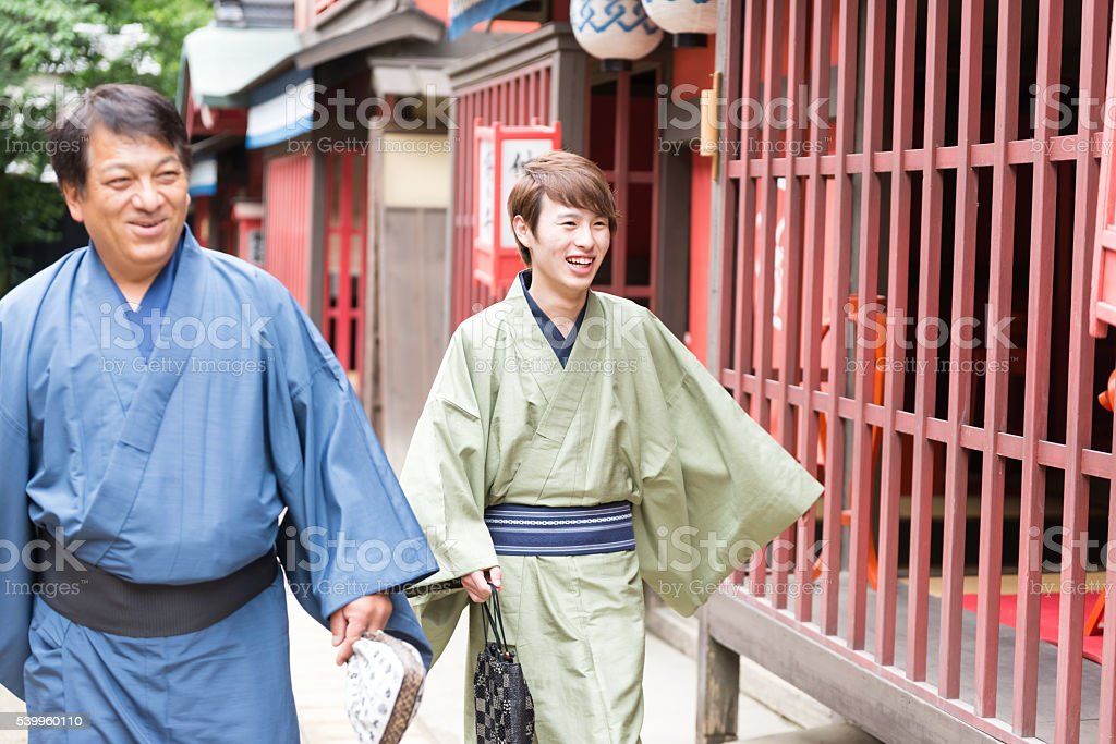 Two Japanese men in Yukata on a alley stock photo