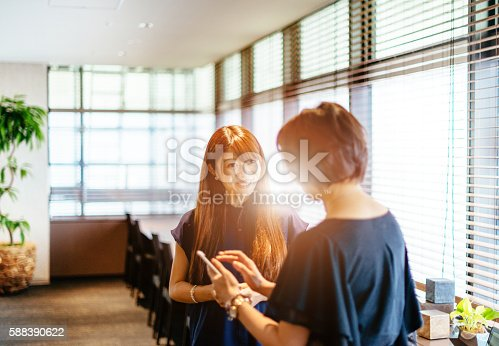589445574istockphoto Two Japanese women in modern interior 588390622