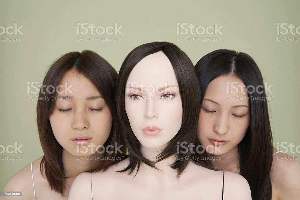 Two japanese women with a mannequin royalty-free 스톡 사진