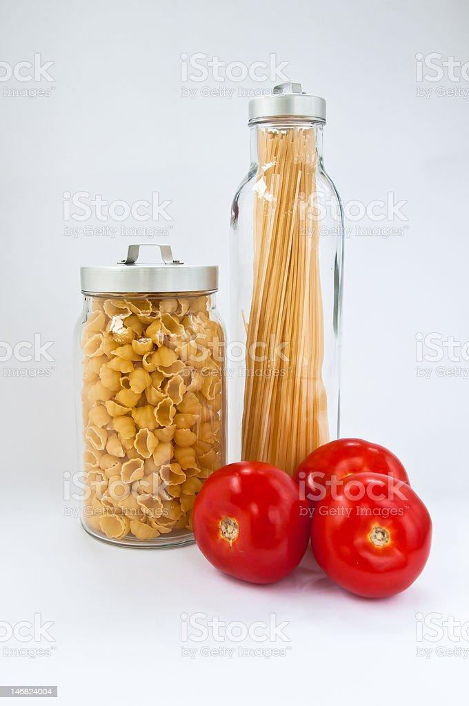 Two jars of dry pasta stock photo
