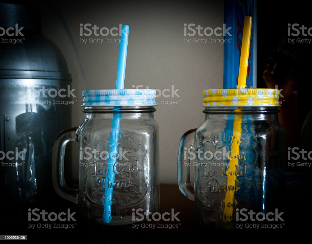 Two jars with colored straws - foto stock