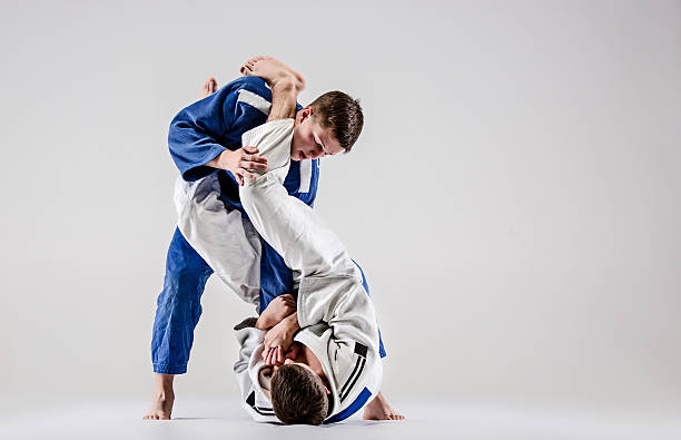 Two judokas fighters fighting men - foto de stock
