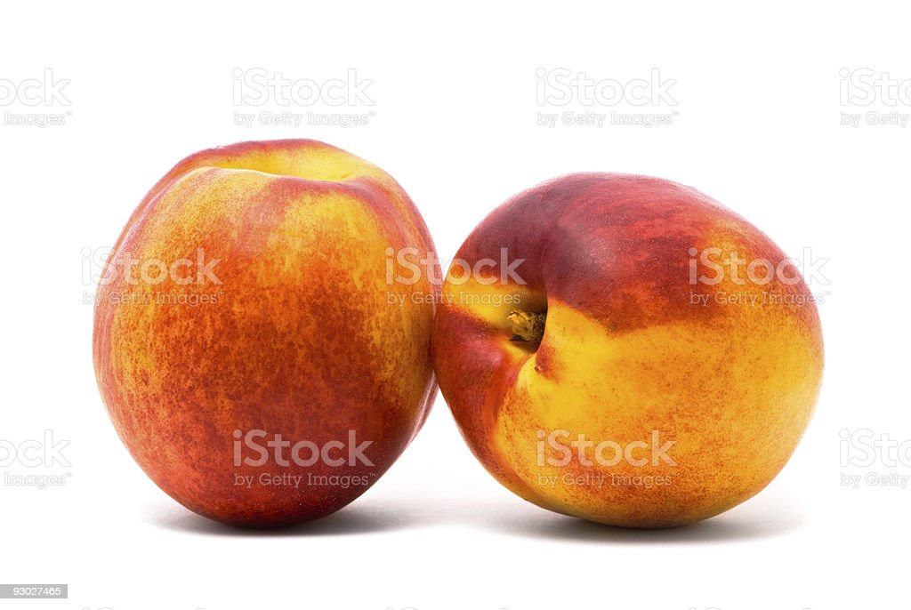 Two juicy nectarines stock photo