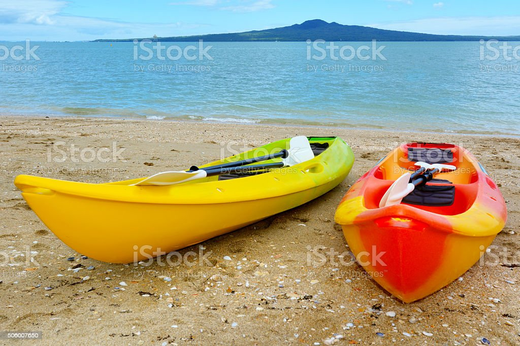 Two kayaks against Rangitoto Island - New Zealand stock photo
