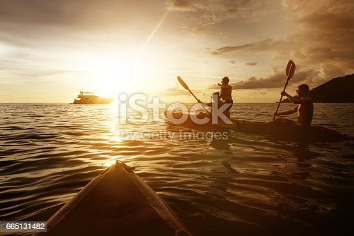 Two kayaks swimming at in sunset sea. Travel and family life concept