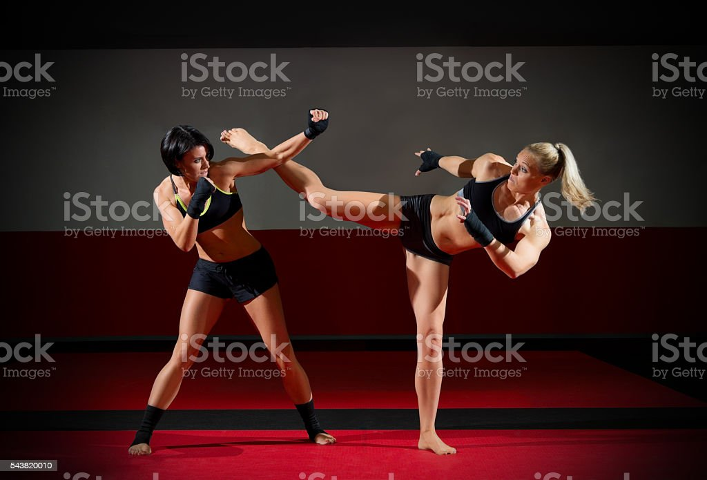 Two kickboxers women stock photo