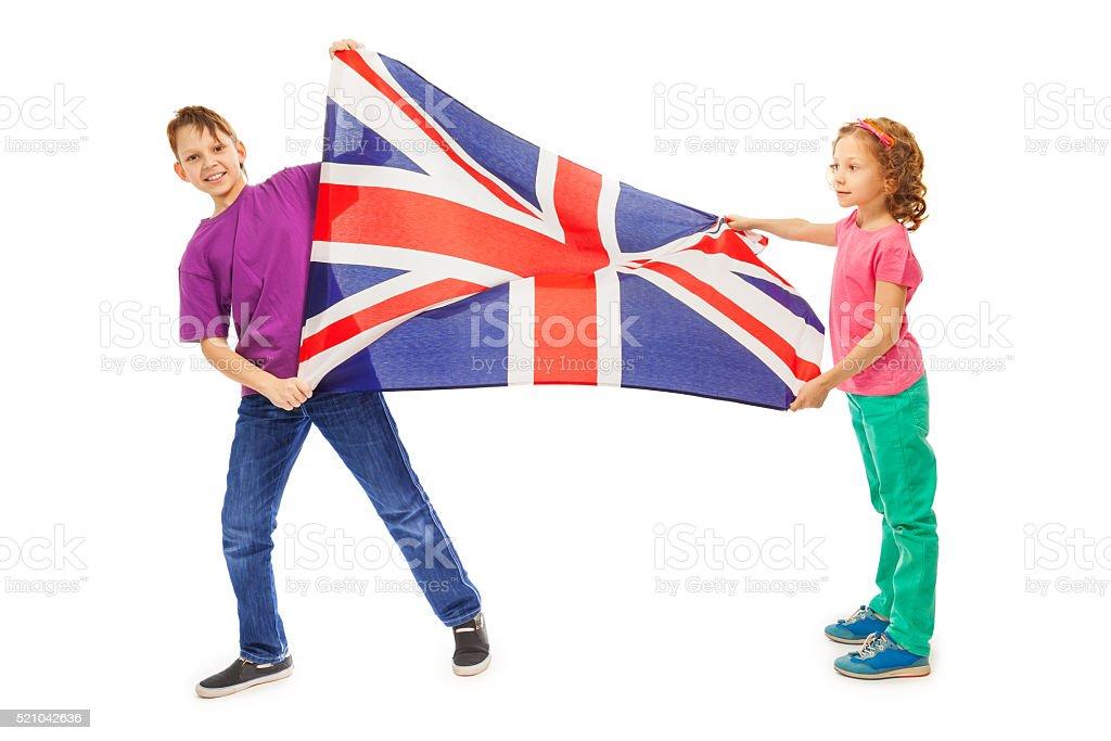 Two kids, boy and girl waving English flag stock photo