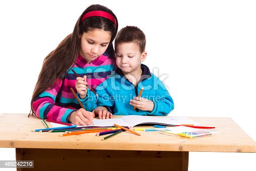 818512928istockphoto two kids drawing together 469242210