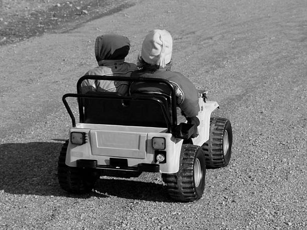 Two Kids Driving a Jeep stock photo