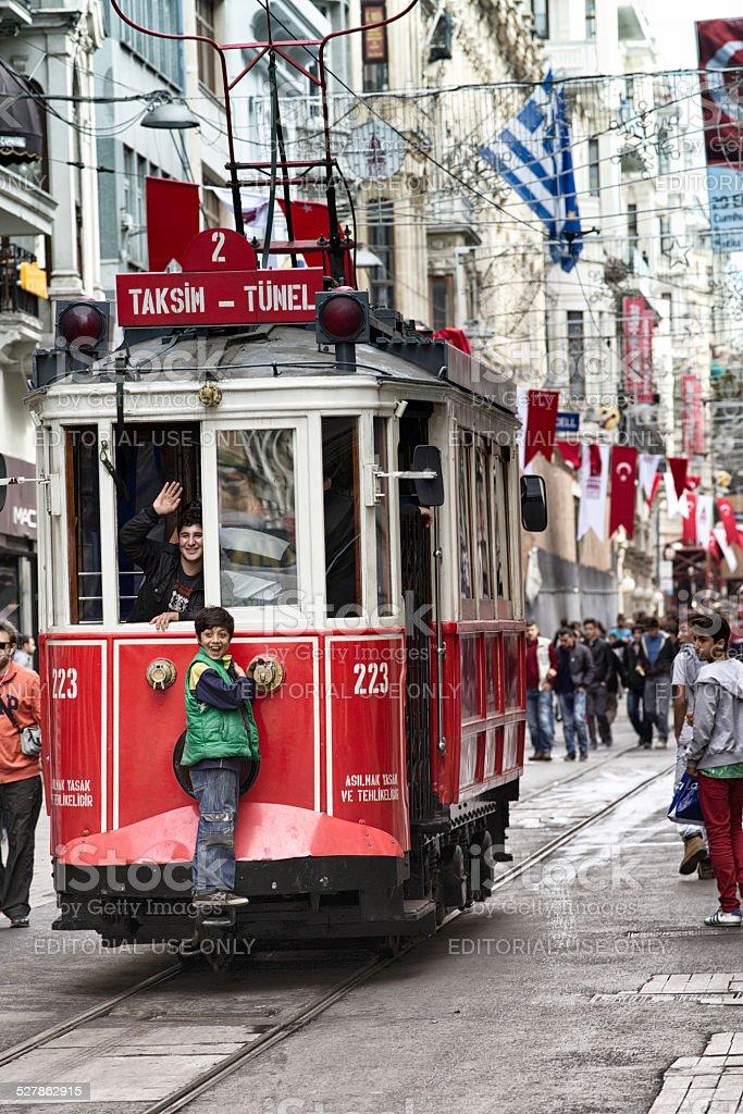 Two kids having fun riding the Istanbul tramway royalty-free stock photo