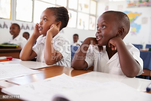 istock Two kids listening during a lesson at an elementary school 803141114